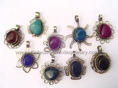 Assorted Agate Stone Pendants. Click the link to purchase our unique handmade Peruvian jewelry at awesome wholesale prices (includes shipping & insurance!)  Make money with your own online or offline business selling Peruvian Jewelry or save big on beautiful gifts for yourself or that special someone! Click here:  http://www.wholesaleperuvianjewelry.com/
