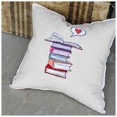 This bookish throw pillow would be perfect for a library or a reading nook