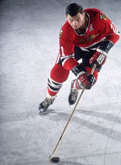 Stan Mikita skates with the puck during a Blackhawks-Bruins game on Dec. 15, 1965 in Chicago. A nine-time All-Star and two-time MVP, Mikita played his entire 22-year NHL career with the Blackhawks. The Hall of Famer turned 75 years old today. (Neil Leifer for SI)