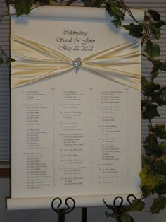 Wedding Reception Seating Chart  love the satin and crystal pin!!