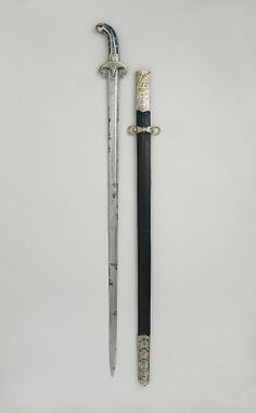 """1650-1700 Turkish Sword and scabbard at the Metropolitan Museum of Art, New York - From the curators' comments: """"The nielloed silver moutns are typical of Ottoman weapons, although the use of lapis lazuli are rare. The straight European blade suggests that this cavalry weapon was carried in addition to the more usual curved saber. Pairs of weapons with straight and curved blades were common in eastern Europe in the seventeenth century."""""""