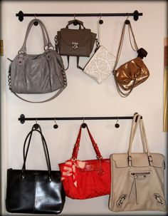 Display/hang handbags behind a door with towel rod and shower hooks.