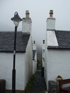 Workers Houses, Ellenabeich | Rows of white cottages in the white mist of the day, Ellenabeich, Seil