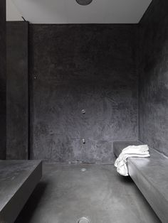 Dark Grey Plaster Shower.....would be soooo easy to clean. Black concrete. Dramatic grotto like wet room.