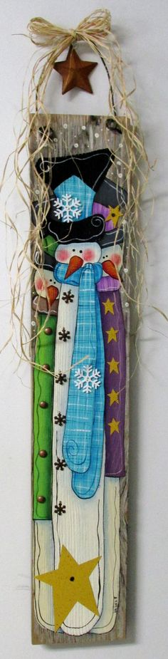 Folk Art Snowmen, Hand Painted on Barn Wood, Winter Wall Hanging Art, Rustic Barn Wood, Reclaimed Barn Wood, Three Snowmen,Primitive Snowmen  These winter snowman would be a fabulous welcome for any winter time guests! This design is based on a Monkia Brint design. It has been adjusted and adapted to fit on to a piece of old reclaimed barn wood. The barn wood measures 29 1/2 inches tall x 7 1/2 inches wide and is 34 inches tall to include the fencing wire. Fencing wire is used as a hanger…