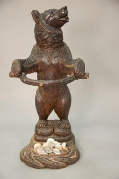 19th Century black forest carved standing bear umbrella stand with glass eyes.  ht. 34 1/2 in.; wd. 18 1/4 in.; dp. 18 in. Realized Price: $2,280.00