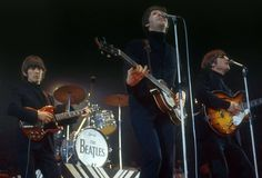 The Beatles play at the New Musical Express Awards in London, In front, from left: Paul McCartney, George Harrison and John Lennon. Paul Mccartney, Great Bands, Cool Bands, Beatles Bible, Beatles Guitar, Beatles Albums, The Beatles Live, The Yardbirds, Beatles Photos