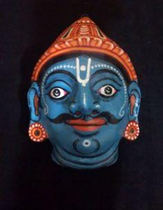 A pattachitra papier mache mask of archer Arjun by PattachitraNet