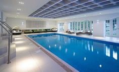 This indoor swimming pool area is pretty huge and has a good seating space beside the pool. Description from faburous.com. I searched for this on bing.com/images