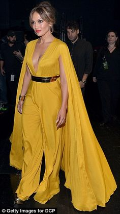 Going for color: The singer opted for eye-catching yellow in a chic jumpsuit, then bright ...