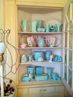 If you're desperate for some color, let vibrant hues shine through your china display. This HGTV fan used a distressed glass-front cabinet to display her favorite porcelain accessories in aqua, turquoise and pink. Looking to expand your colorful collection? Thrift stores and garage sales are full of similar pieces looking for a new home.