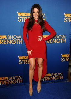 Khloe Kardashian  The reality star stepped out without her signature animal print, and she looks fabulous. Mrs.Odom should always wear red, and the sleek hair and mullet hem are super flattering. Brava