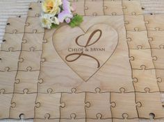 Custom Heart Wedding Guest Book Puzzle by Northern Owl Creations. Wedding Guest Book Puzzle with your Custom Logo on the main piece. Each piece has Tiny Heart Tabs!  Custom by NorthernOwlCreations