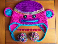 Neon Child Monkey Hat.... This is too cute, I might have to see if I can make it for my huge noggin.