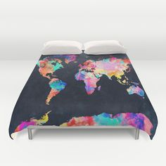 World map Duvet Cover. Cover yourself in creativity with our ultra soft microfiber duvet covers. Hand sewn and meticulously crafted, these lightweight duvet covers vividly feature your favorite designs with a soft white reverse side. A durable and hidden zipper offers simple assembly for easy care - machine washable with cold water on gentle cycle with mild detergent. Available for King, Queen and Full duvets - duvet insert not included. *Queen duvet works for Twin XL beds.