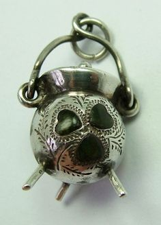 An Edwardian silver cauldron charm with moving handle and set with shamrock shaped connemara marble pieces, registered design number for 1909 -38gbp