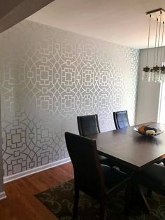 A DIY stenciled dining room accent wall using the Tea House Trellis, a popular Moroccan wall pattern, from Cutting Edge Stencils in a silver metallic paint. http://www.cuttingedgestencils.com/tea-house-trellis-allover-stencil-pattern.html