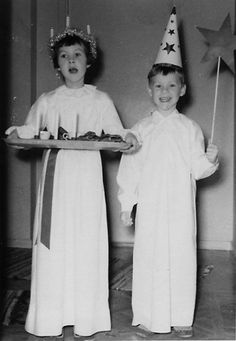 Santa Lucia and a Star Boy, 1957 from the Västergötlands museum. December 13th is the Feast of Santa Lucia, saint of light