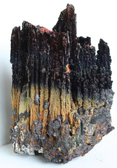 This chunky raw stalactite mineral specimen is a cluster of hollow metallic tubes of goethite, a hydro-thermally formed mineral with banded