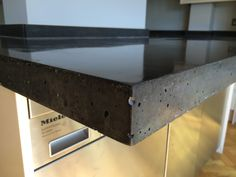 Detail Of 10 Black Oxide Polished Concrete Island Countertop Unit With Cantilever Breakfast Bar