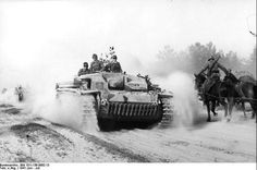 01b5d9f1145a9 ... Russian front A German  Sturmgeschütz  - an assault gun moving along a  typical Russian road during the early stages of Barbarossa · World Of TanksWw2  ...