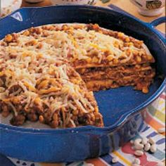 """Tortilla Stack--I would totally alter this recipe to be more of a """"taco"""" stack, then top with fresh tomato, lettuce and sour cream...but the baking in the pie dish is a great idea!  Might even try a cheese and broccoli one with riccotta...any pizza variation would work with this!"""