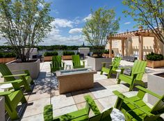 Rooftop terrace with fire pit, trellis areas, lounge seating and grilling stations at AMLI Evanston, a luxury apartment community near Chicago.