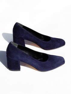 """Classic pump in smooth leather with a slightly squared toe and 2 5/8"""" block heel. Slips on. Fits true to size. Made in Turkey. Color: Navy Suede Sizing: American"""
