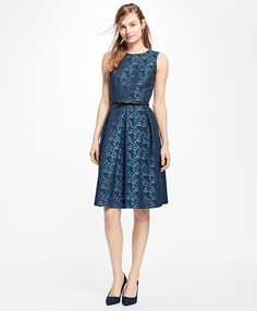 """<a href=""""#pdplearnmore"""" class=""""lm"""">The Red Fleece Collection</a><br>Fully lined in an Italian cotton blend, this sleeveless dress features a floral jacquard design with a full pleated skirt, side seam pockets and a center back zipper.<br><br>39""""; dry-clean only; fabric from Italy; imported."""