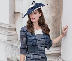 STYLE 26192 | This graphic, cut out lace is simply sensational. Enhancing the refined shape, the stripes highlight an hourglass figure. Classically romantic, this exquisite pattern continues on the tailored crop jacket and wide brim hat. Gorgeously understated style for an unforgettable occasion.