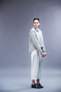 The always-innovative Olga Buraya-Kefelian brings us a modern pullover in Shelter, pairing a high-relief fabric with bold construction for a futuristic look. Slender welts accentuate the scoop of the hem, which is shaped with short rows to produce a silhouette Audrey Hepburn would have coveted, and the perfect ring collar completes the effect.