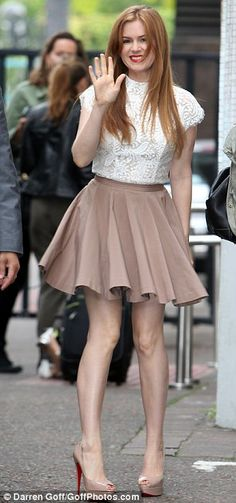 Isla Fisher in a Lover lace top & skate skirt