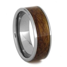 Raise a glass for this whiskey barrel wood ring for the man's man wedding. The oak wood inlaid in the tungsten ring originates from an authentic whiskey...