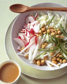 Cabbage and Radish Slaw with Peanut Dressing | Martha Stewart Living - In a coarsely cut cabbage-and-daikon-radish slaw, many of the components -- the peanut dressing with ginger and soy sauce, as well as the daikon -- give it an unmistakably