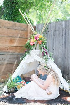 Boho baby shower via 100 Layer Cakelet. Floral bohemian teepee. Location   The Studio Collective: Grass Valley, Ca, Floral Design   Bee, Leaves N' Love, Vintage Rentals   Roots Reclaimed, Photography   Lydia Photography, Event Coordinator   Tasha Gold Events