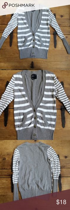 American Eagle Striped Women's Cardigan White and gray striped  four-button cardigan from American Eagle Outfitters.  This AEO sweater has ribbed long sleeves and two cute front pockets.  Excellent condition!! Perfect for a stylish fall/winter look. American Eagle Outfitters Sweaters Cardigans
