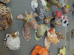 animal trophies.  Each student create their own armature out of newspaper and masking tape. Two layers of paper mache later, we had some funky animal trophies. Our final coat of paper was either sheet music, scrapbook paper or tissue paper. We applied an acrylic glaze on top to seal all the paper layers