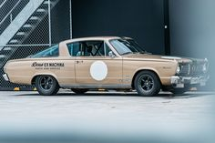 They're best known for their custom motorcycles, but as this Deus Ex Machina 1966 Plymouth Barracuda, they're equally adept at modding four-wheeled vehicles. Built and owned by Matt Hart, this Italian series one is powered by a 273 engine. Plymouth Barracuda, Pontiac Gto, Chevrolet Camaro, 1966 Gto, Deus Ex Machina, Garage, Car Wheels, American Muscle Cars, Car Manufacturers