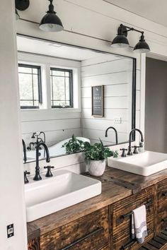 This farmhouse bathroom makes use of shiplap walls with a beautiful rustic bathroom vanity. Two farmhouse lights are used on top of each side of the mirror. Rustic Vanity, Rustic Bathroom Vanities, Modern Farmhouse Bathroom, Bathroom Ideas, Small Bathroom, Bathroom Organization, Bathroom Interior, Farmhouse Vanity, Rustic Farmhouse