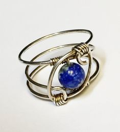 Lapis Lazuli Ring Lapis ring wonderfully spiraled and wrapped in sterling silver wire . Lapis Lazuli gemstone is a wonderful brilliant blue stone consisting of a mineral lazurite with beautiful white specks of calcite and other minerals. Natural ultramarine pigment was made from #wirewrappedringsstones