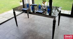 The Epoque Black Glass Extending Dining Table combines elegance and flexibility wonderfully. The tempered black glass top is superbly supported by a stylish chrome frame and slim baroque-style black legs. If you are looking for an Italian Designer statement dining table for your dining room and require something which is easy to extend to accommodate extra guests, then the Epoque table is for you. The top smoothly extends from 1600mm to 2200mm to comfortably seat 8 people. £449.00