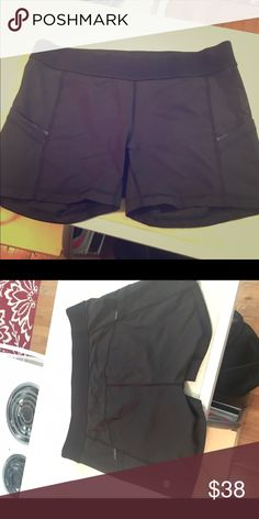Black lululemon what the sport shorts What the Sport Lulu shorts, size 10. Very comfortable and pockets are super useful. Wore a few times before finally accepting I bought the wrong size. Have been washed 2-3 times but in great condition. lululemon athletica Shorts