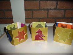 MAP: kleuters prikken kerstfiguren uit, gemaakt van goudkarton....kerstfiguren kunnen ook weer gebruikt worden.