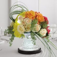 roses combined with the crystal gel in the vase and uplighted with a vase light