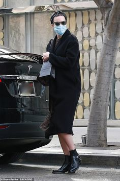 Mandy Moore covers up her baby bump with black winter coat as she goes shopping in Beverly Hills | Daily Mail Online Baby Cover, Cover Up, Black Winter Coat, Mandy Moore, Baby Bumps, Go Shopping, Mail Online, Daily Mail, Beverly Hills
