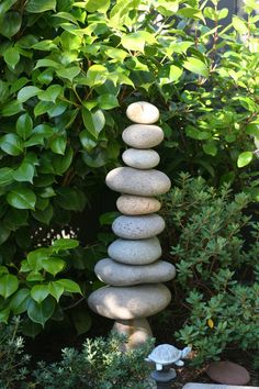 River rock garden sculpture. Would need to glue together to keep them there.  Lol!