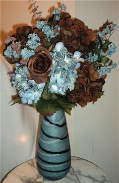 Researching for a new logo identity. I find inspiration for color schemes in floral arrangements.    Google Image Result for http://acimg.auctivacommerce.com/imgdata/0/1/2/0/6/3/webimg/3253072.jpg