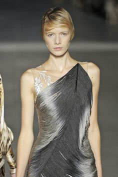 McQueen being brilliant again, you must click through to see the back of this dress