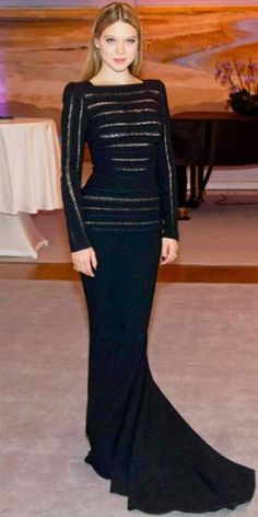 Actress Lea Seydoux attended the L'Enfant d'En Haut red carpet premiere at the 2012 Berlinale Film Festival in this gorgeous, black wool Elie Saab long-sleeved gown with lace detailing.