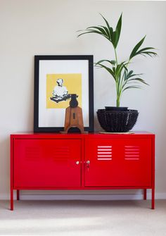 Red Ikea PS unit #myflatpack. Queenie art print #Component #endemicworld.com. Black woven basket #freedom. Vintage print block #inthevitrine. PlacesandGraces Home Staging.